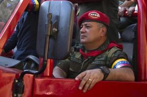 Venezuela's National Assembly President Diosdado Cabello drives a car during a rally to commemorate the 23rd anniversary of a 1992 coup attempt led by former President Hugo Chavez, in Caracas February 4, 2015. REUTERS/Marco Bello